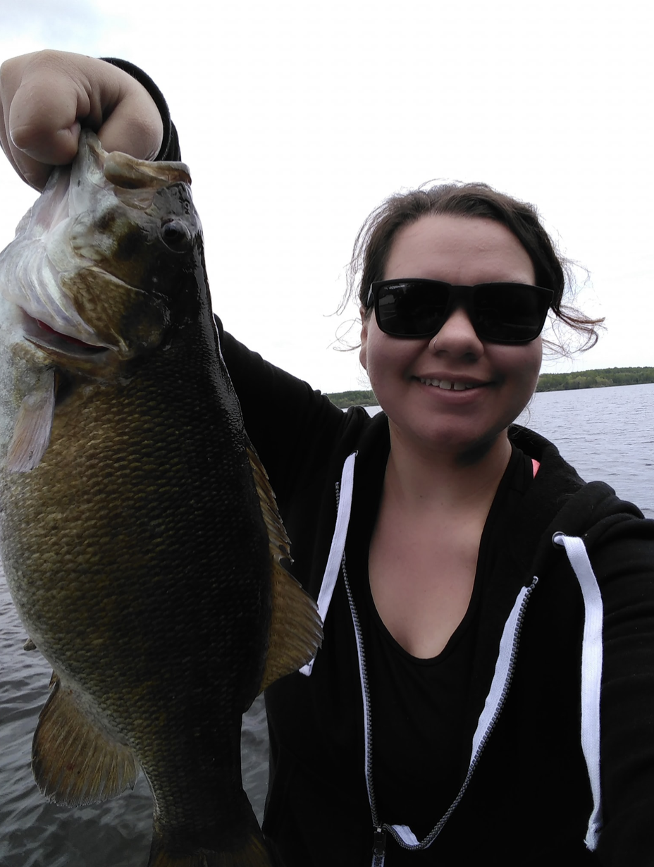 Mobilizer catching fish at her tourism job in Lake of the Woods, Ontario.